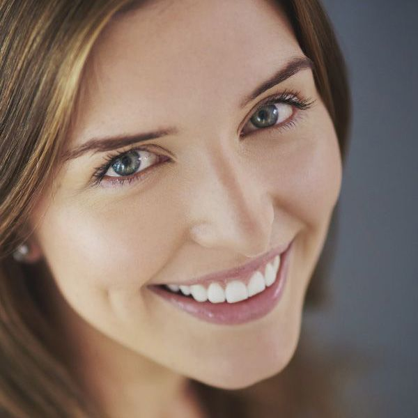 A smiling woman with dark hair.