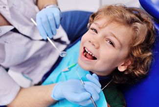 image of smiling child at dentist