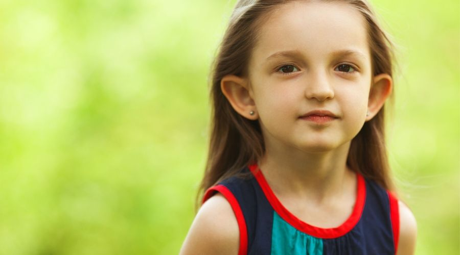 child with protruding ears