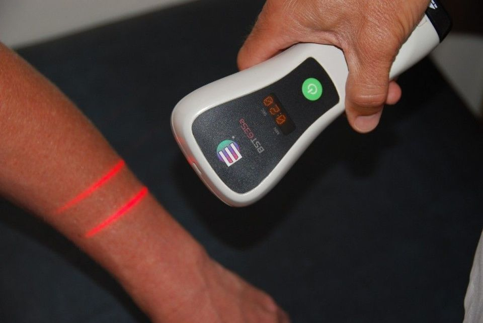 Photo of a patient receiving cold laser therapy