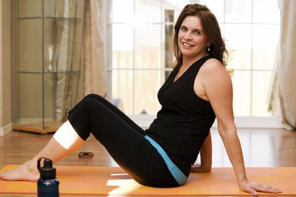 Reclining smiling woman in workout clothes