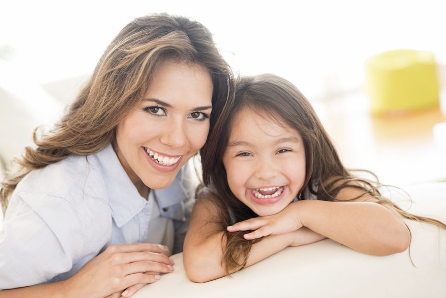 Photo of a smiling woman and child