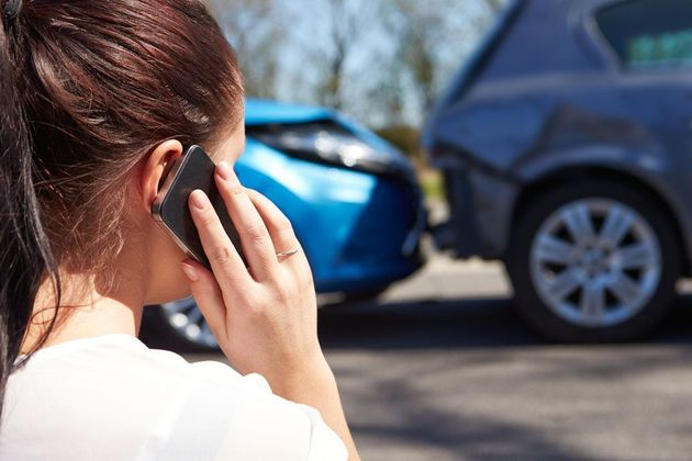 woman calling police after an accident