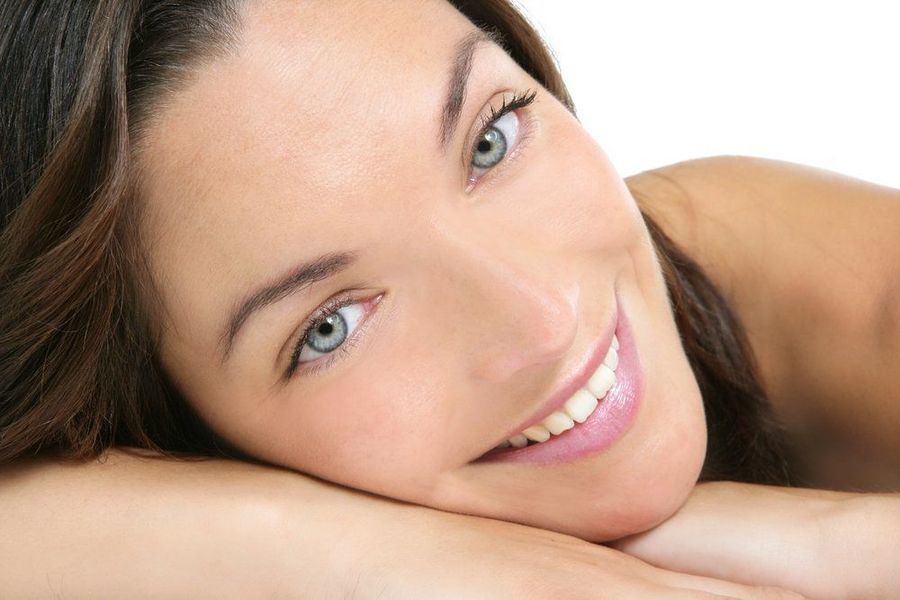 brown haired attractive woman leaning face on her arm