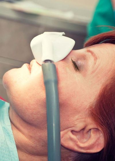 Woman with nitrous oxide mask over her nose