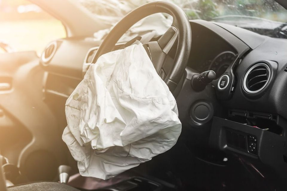 An deployed airbag after an accident