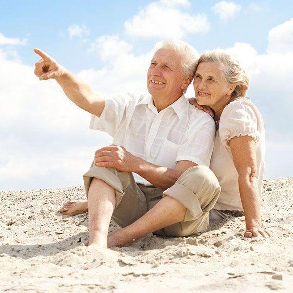 Older couple sitting on beach