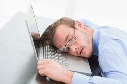 man asleep on keyboard
