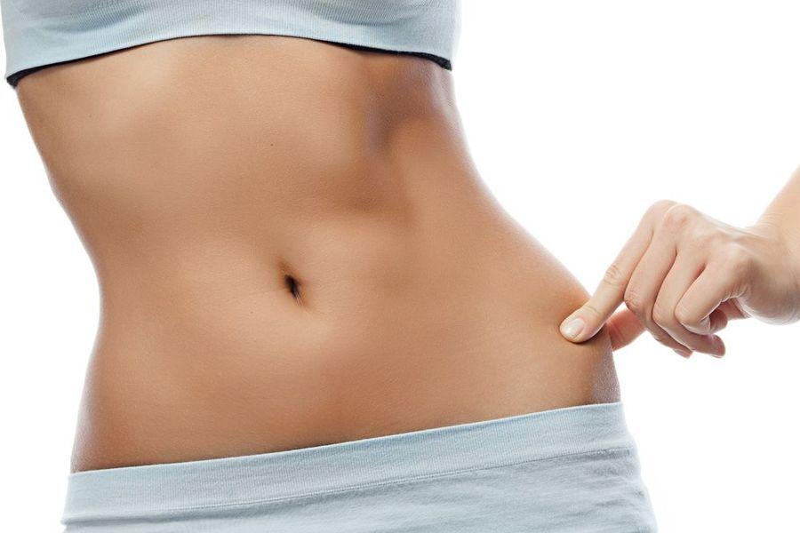 Woman pinching slim waist