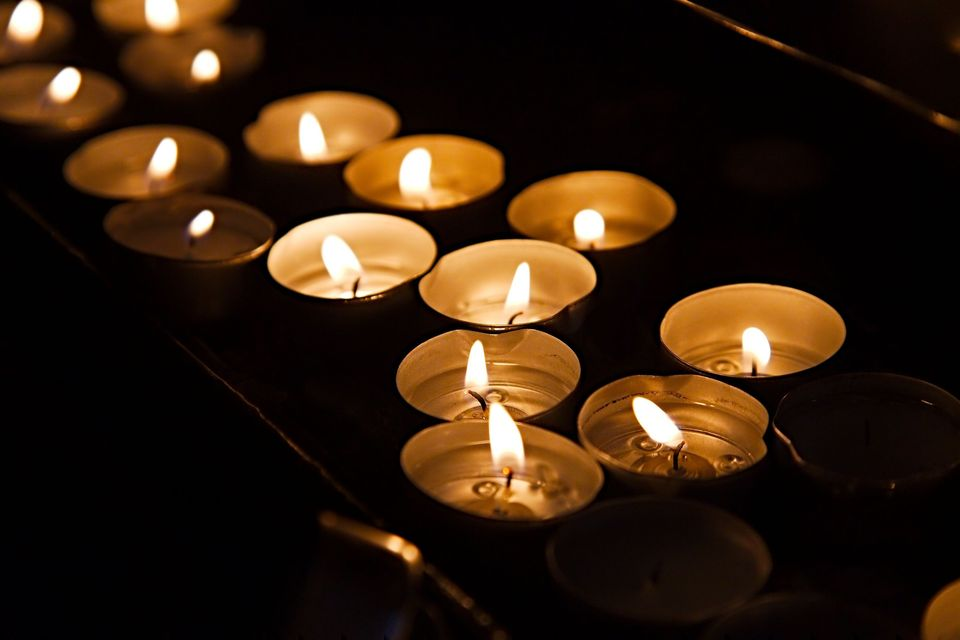 Candles burning in memory of a loved one.
