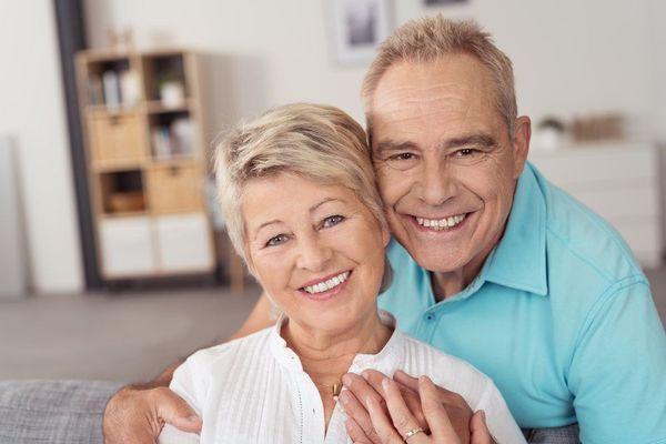 A senior couple smiling at the camera
