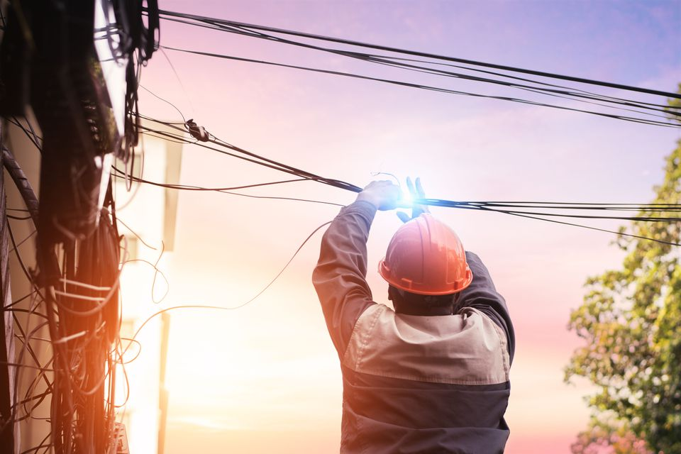 Worker touching live power lines