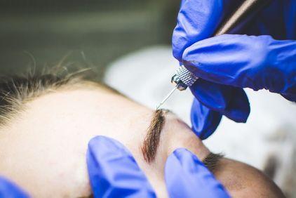 Woman undergoing microblading procedure