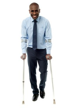 Smiling man on crutches