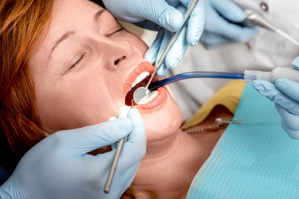 A patient undergoes dental treatment with IV sedation.