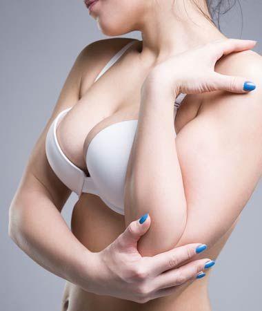 Woman's bust in white bra