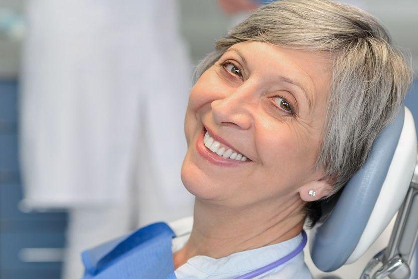 Smiling female dental patient