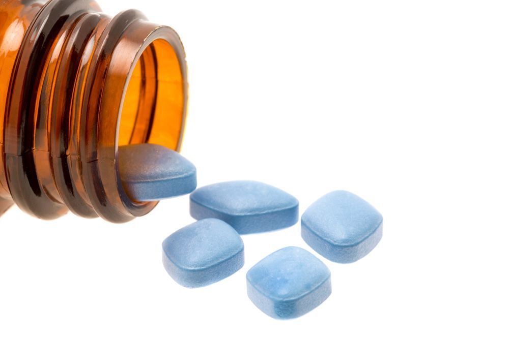 Pill bottle dispensing blue pills