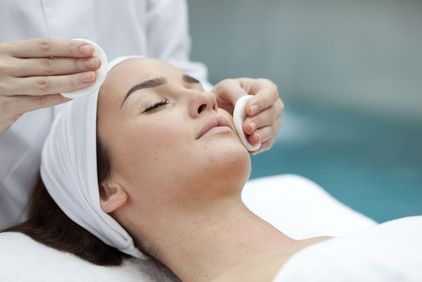 Woman receiving injectable treatment in her cheek.