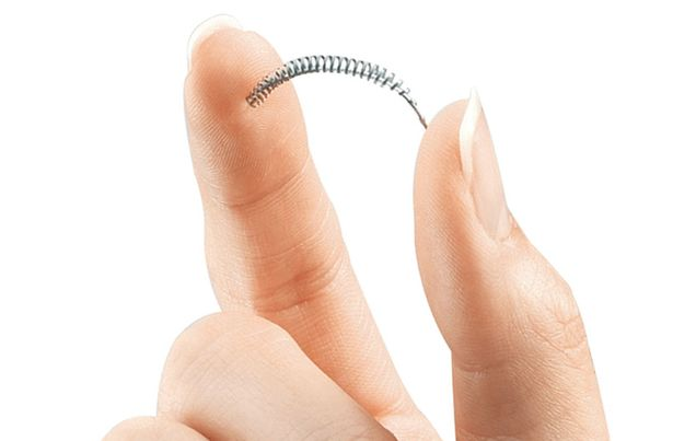 Essure device between fingertips