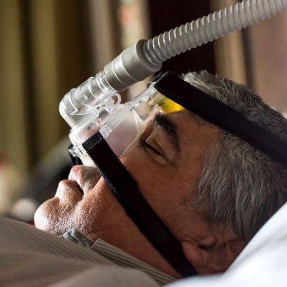 A brunette woman smiles after receiving sleep apnea treatment
