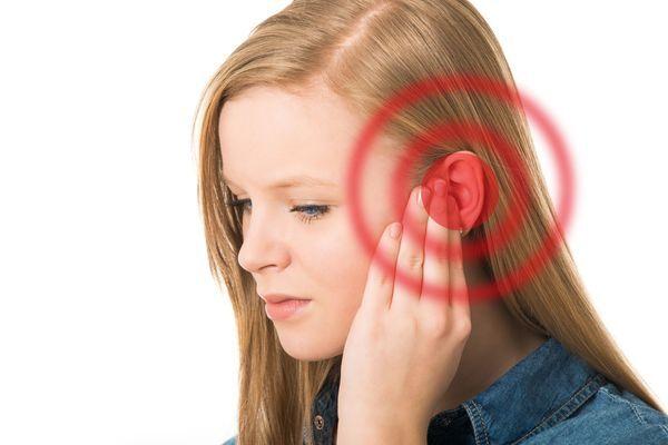 Woman rubbing her ear
