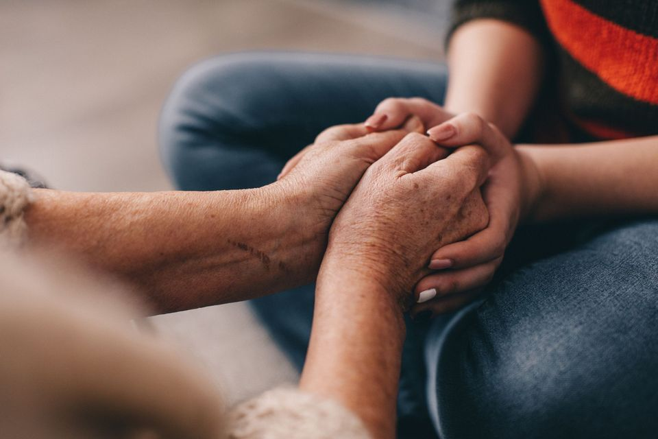 holding an elder's hands