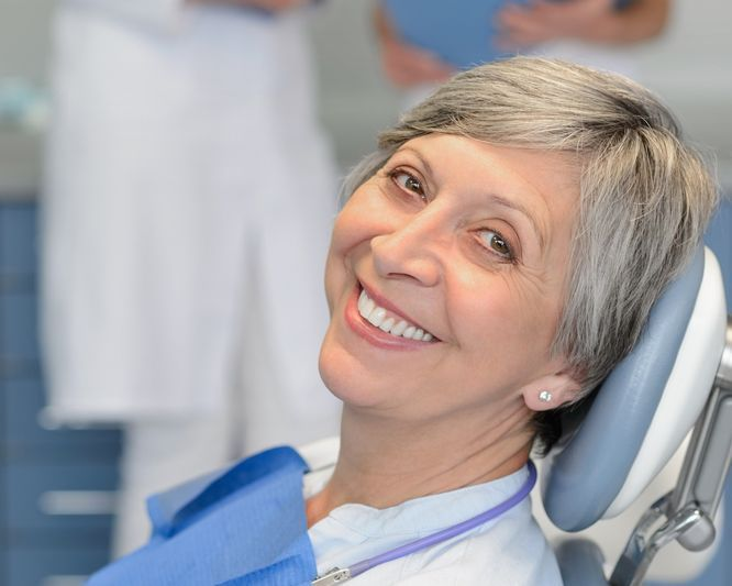 An older female patient in a dental chair