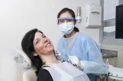 A young woman undergoing a routine dental cleaning