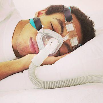 Man using a CPAP machine during sleep.