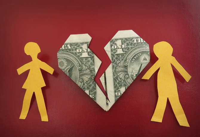 paper dolls and a dollar bill folded in the shape of a broken heart