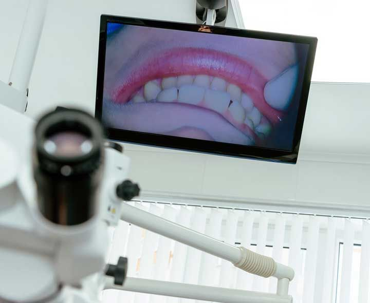 Dental patient's mouth on monitor