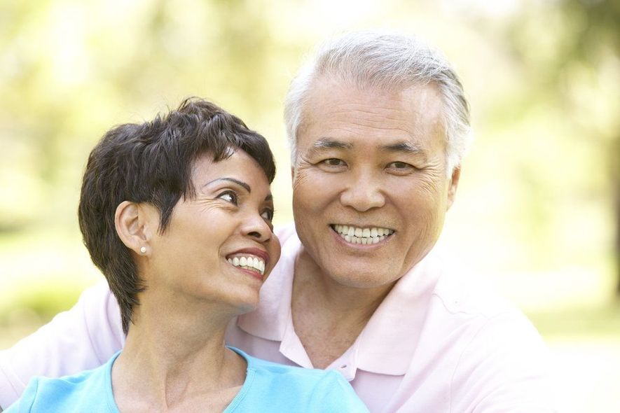 An elder couple smiles and enjoys the outdoors