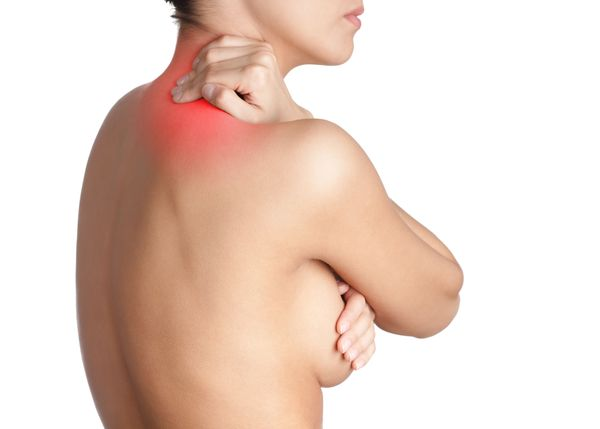 Woman holding breast and neck highlighted to show pain
