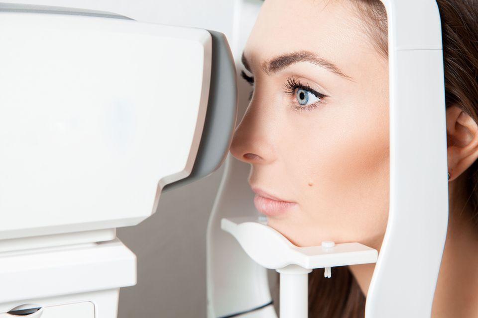 Patient undergoing an astigmatism test