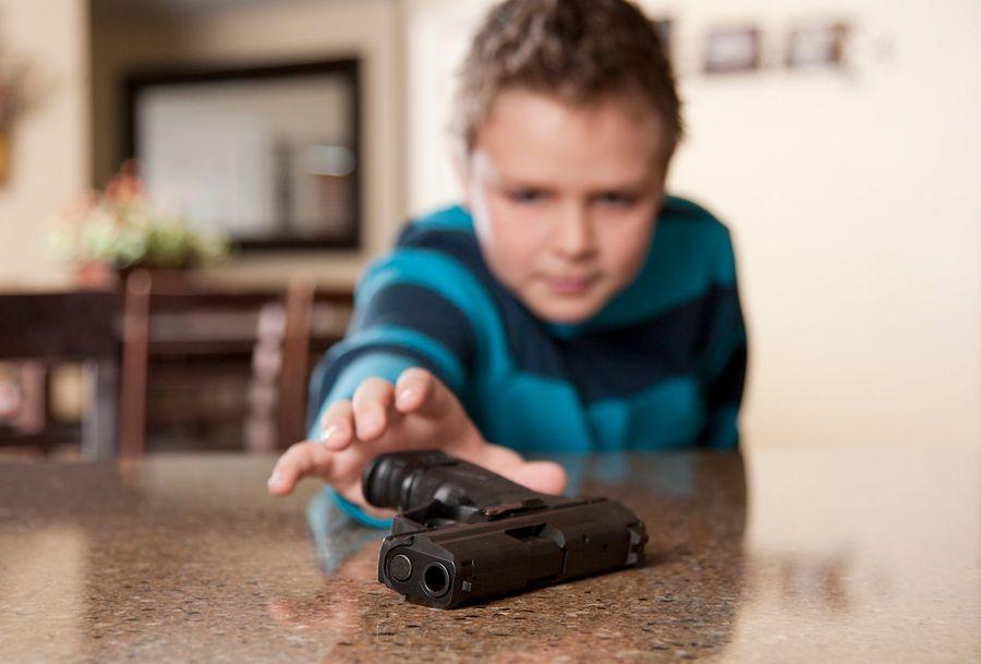 Child reaching for a gun