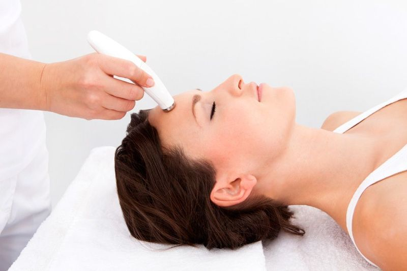 woman receives microdermabrasion