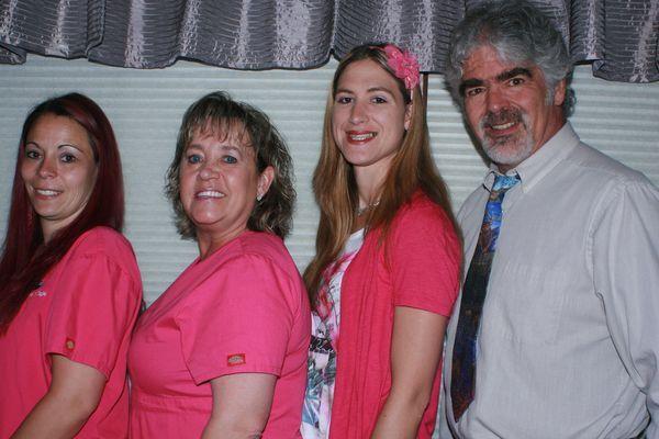 Dentist Shainholtz with staff members