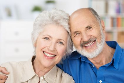 Smiling senior couple posing for picture