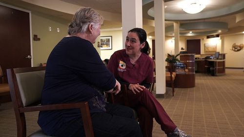 patient speaking with nurse