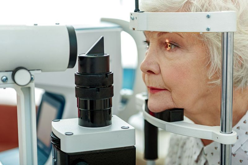 Older woman undergoing eye exam