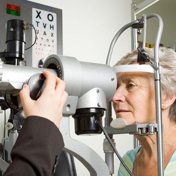 An older woman receiving an eye exam