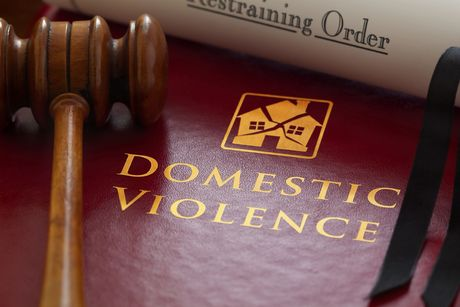 A gavel on a book about domestic violence