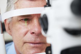 Man undergoing slit lamp exam