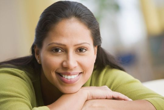Woman resting head on hands and smiling