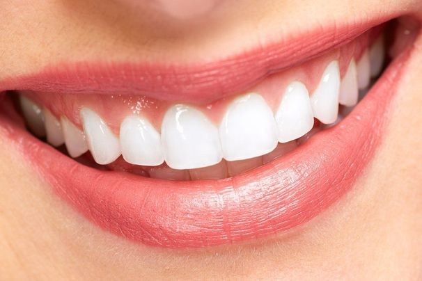 Close up of woman's smile with very white teeth