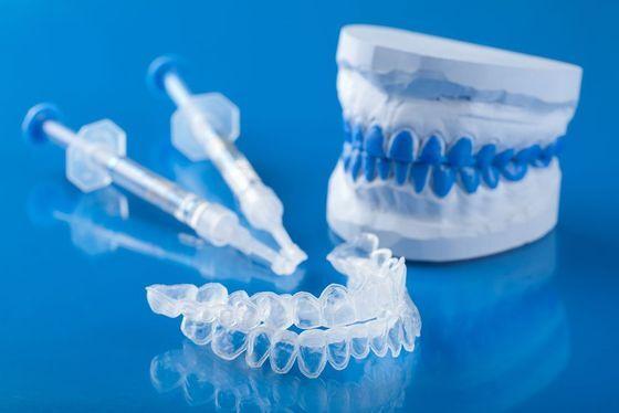 Model of teeth, gel applicator, and clear trays