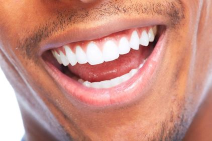 Close-up of a man's white smile