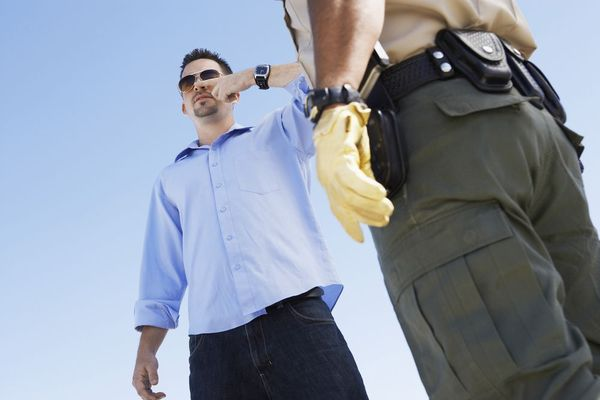 man performing field sobriety test