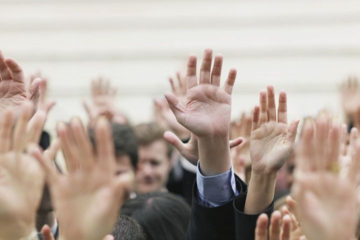 Crowd of raised hands